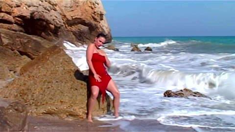 Bit tit blonde stripping on the beach ...photo 3